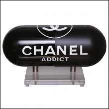 Sculpture in resin with one side in glossy black finish and one side in matt black finish PC-Pils Chanel Addict